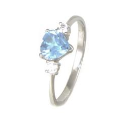 Anillo oro blanco 18 kilates piedra azul corazón.