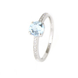 Anillo oro blanco 18 kilates topacio azul y diamantes.